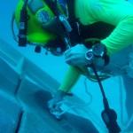 NEEMO diver deploying translation line.