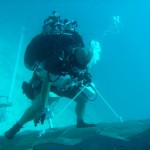 NEEMO diver simulating translation in an asteroid surface with two anchors.