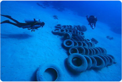 dumped tyres at Eel Garden, Dahab, South Sinai, Egypt