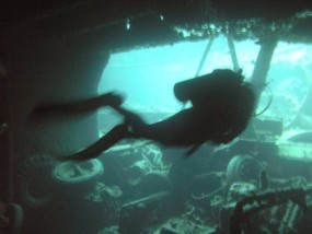 spooky diver inside the wreck